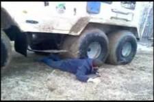 russian guy gets stuck under tire truck WMV V9