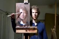 Künstler malt ein Selbstportrait selber